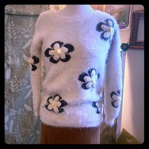 Funky furry sweater with crochet daisy embroidered